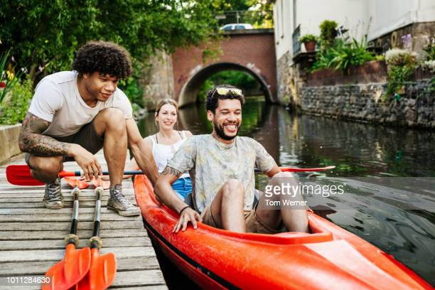 friends getting ready to go paddling in kayak - saxony stock pictures, royalty-free photos & images