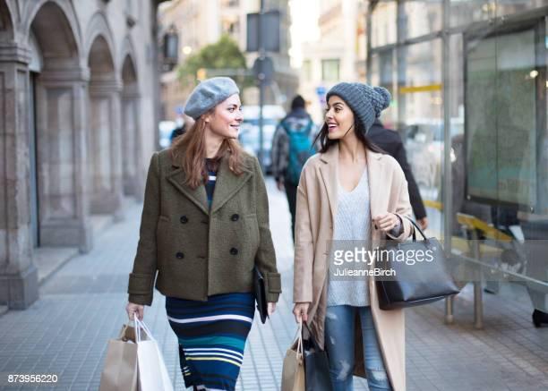 friends go shopping in the city - coat imagens e fotografias de stock