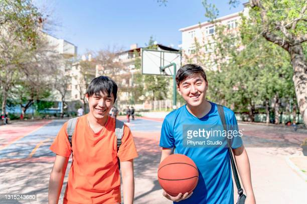 friends going home by chatting after a good basketol game - friendly match stock pictures, royalty-free photos & images