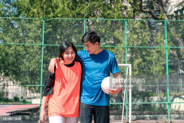 friends going home by chatting after a good soccer game - friendly match stock pictures, royalty-free photos & images