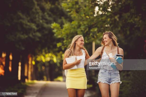 friends going to school together - mini skirt stock pictures, royalty-free photos & images