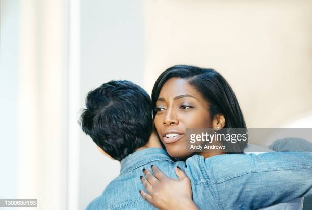 friends greeting and hugging - religious dress stock pictures, royalty-free photos & images
