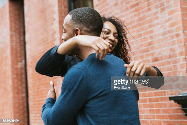 friends greeting each other in new york - reconciliation stock photos and pictures