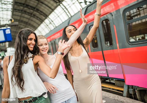 friends greetings on the amsterdam station