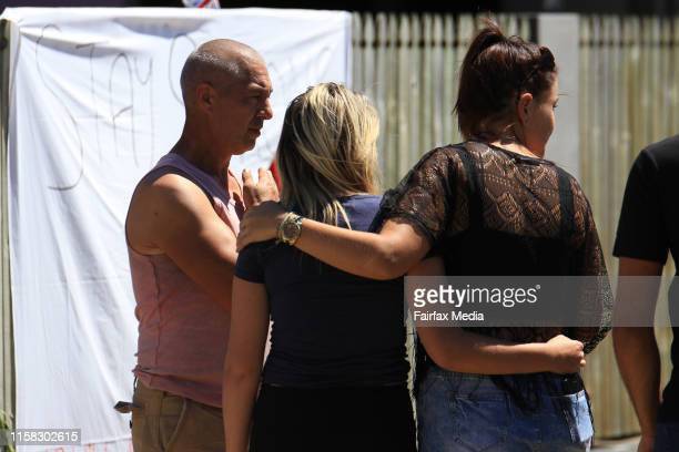 Friends grieve outside tributes to Tom and Mia at the Home Hill Backpackers south of Townsville where Smail Ayad allegedly killed British backpacker...