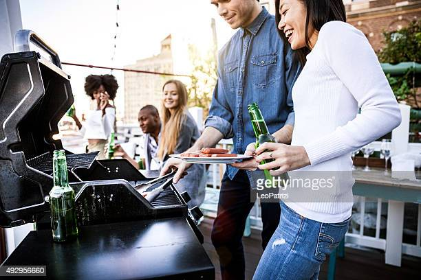 Friends grilling on a rooftop in New York Manhattan