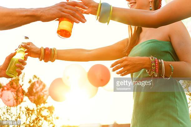 Friends handing out drink on rooftop party