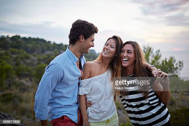 3 friends hanging out and laughing outside - klaus vedfelt mallorca stock pictures, royalty-free photos & images