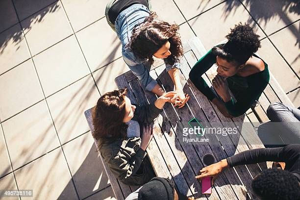 Friends Hanging Out at Park Picnic Table