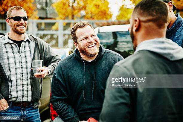 friends hanging out during tailgating party - tailgate party stock pictures, royalty-free photos & images