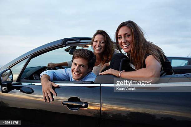 3 friends hanging out in car - klaus vedfelt mallorca stock pictures, royalty-free photos & images