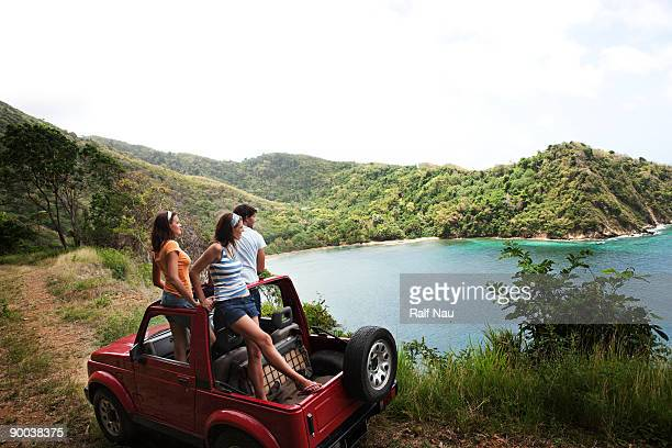 Friends hanging out in jeep looking out