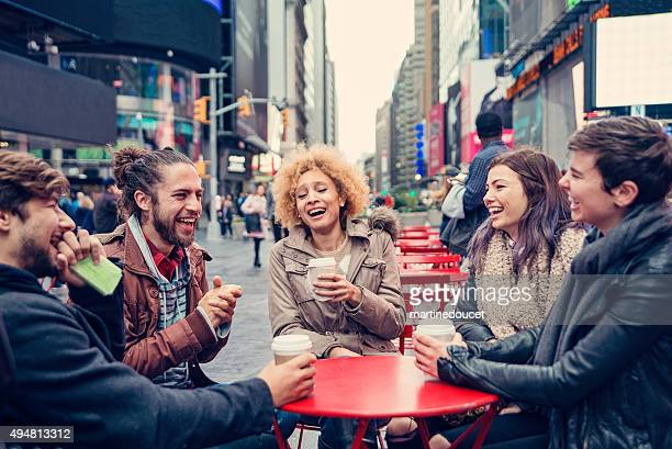 """friends hanging out in public space in times square. - """"martine doucet"""" or martinedoucet stock pictures, royalty-free photos & images"""