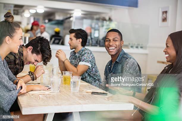 Friends hanging out in restaurant