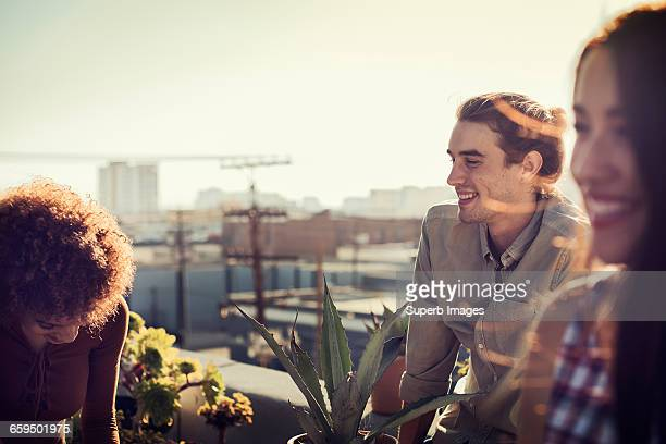 Friends hanging out on an urban rooftop