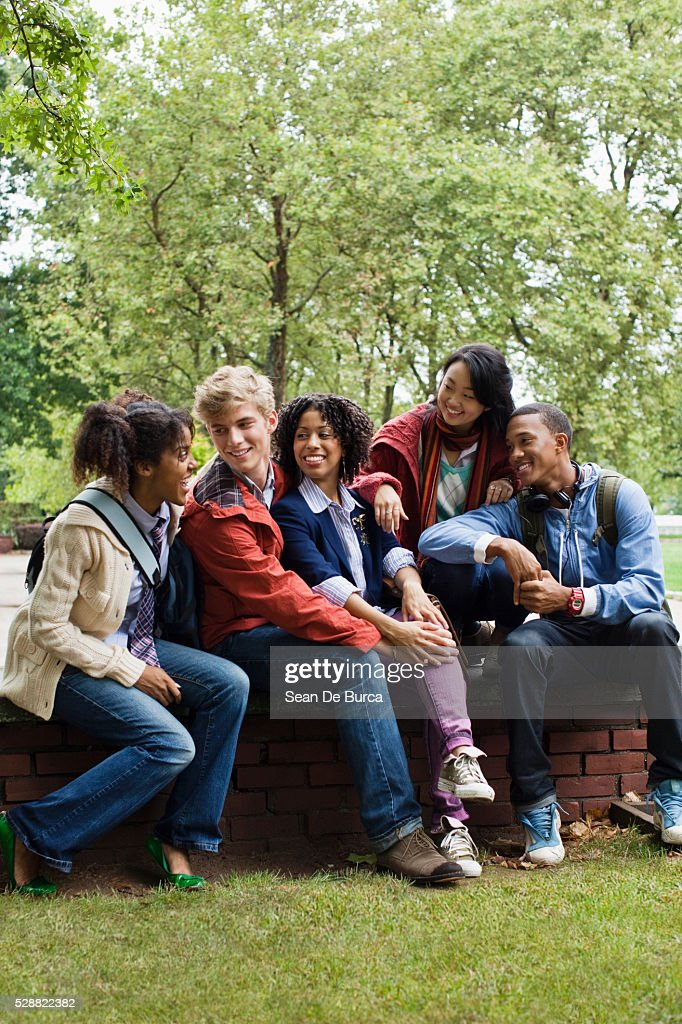 Friends Hanging Out On University Campus High-Res Stock ...