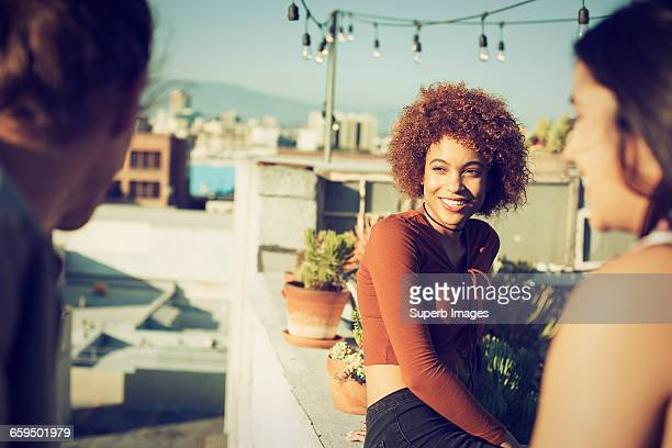 Friends hanging out on urban rooftop