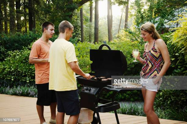 Friends hanging out together barbecuing
