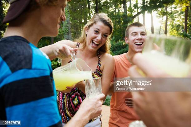 Friends hanging out together drinking lemonade