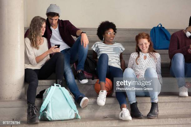Friends hanging out together during break at school