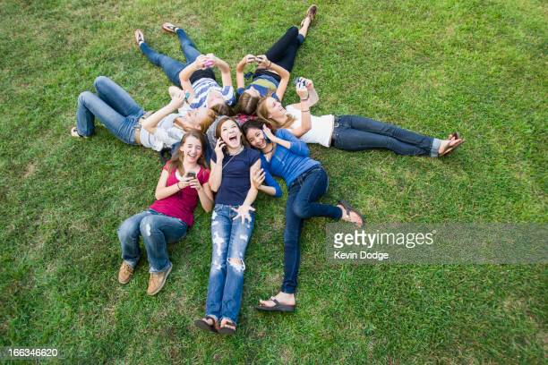 Friends hanging out together on grass