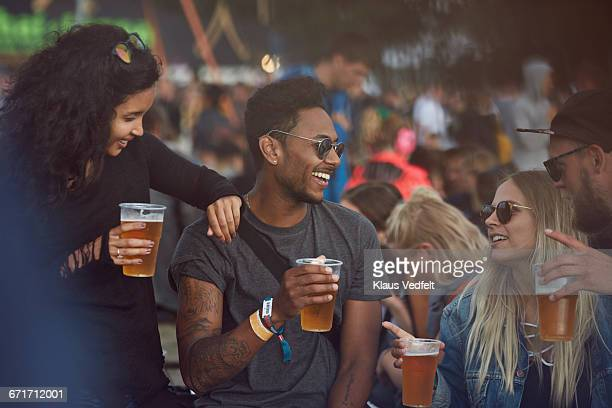 Friends hanging out with beers at festival
