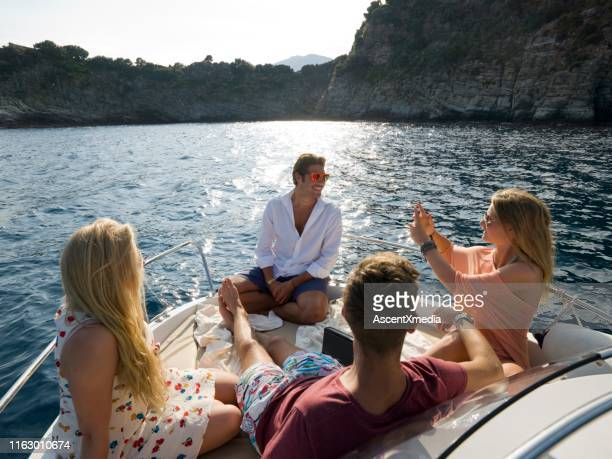 friends hangout on speed boat in mediterranean sea - premium access stock pictures, royalty-free photos & images