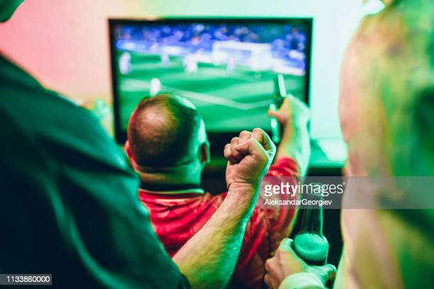friends happy about their favorite club winning soccer match - match sport stock pictures, royalty-free photos & images