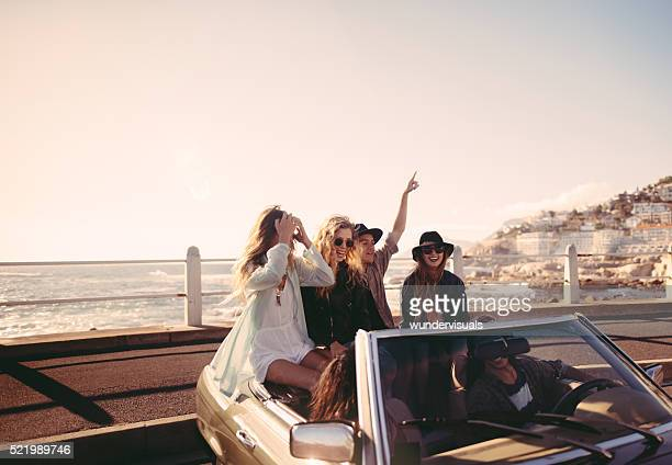 Friends happy to reach the sea on their road trip