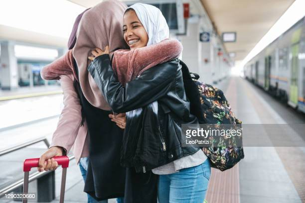 friends happy to see each other again - railway station stock pictures, royalty-free photos & images