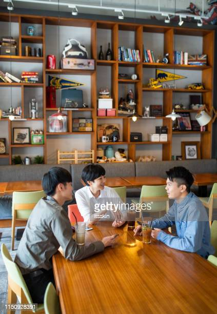 friends have a converstation and drink coffee in a coffee shop - coffee drink stock pictures, royalty-free photos & images