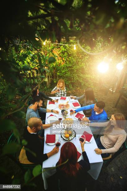 friends have a dinner at agriturismo in italy - chianti region stock pictures, royalty-free photos & images