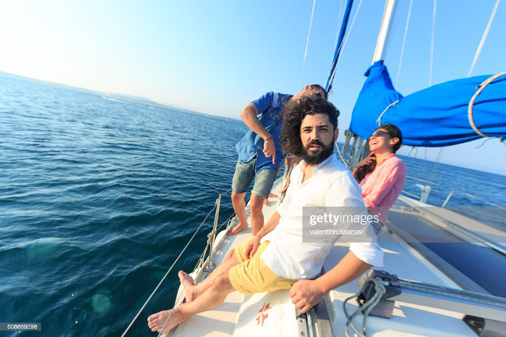 Friends have fun on yacht : Stock Photo