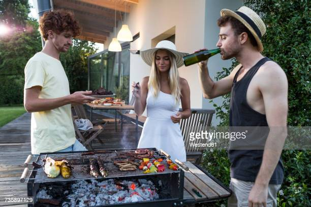 Friends having a barbecue party