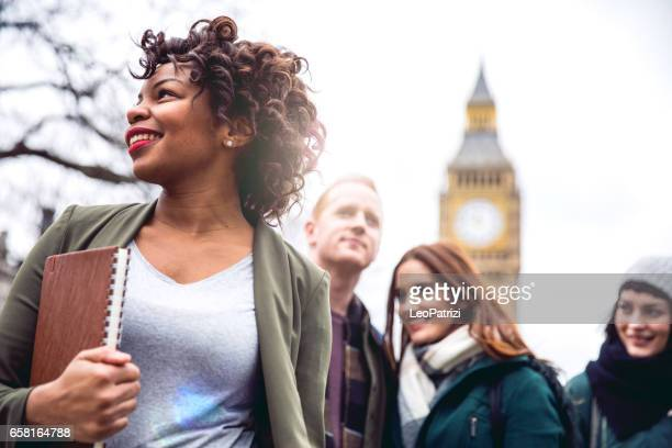 friends having a blast in london - clock tower stock pictures, royalty-free photos & images
