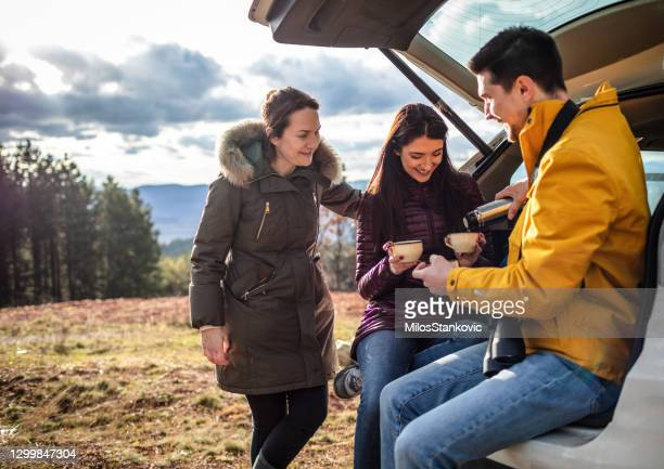 friends having a break from hiking - resting stock pictures, royalty-free photos & images