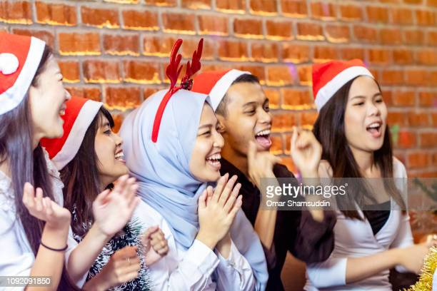 Friends having a good time during Christmas celebration