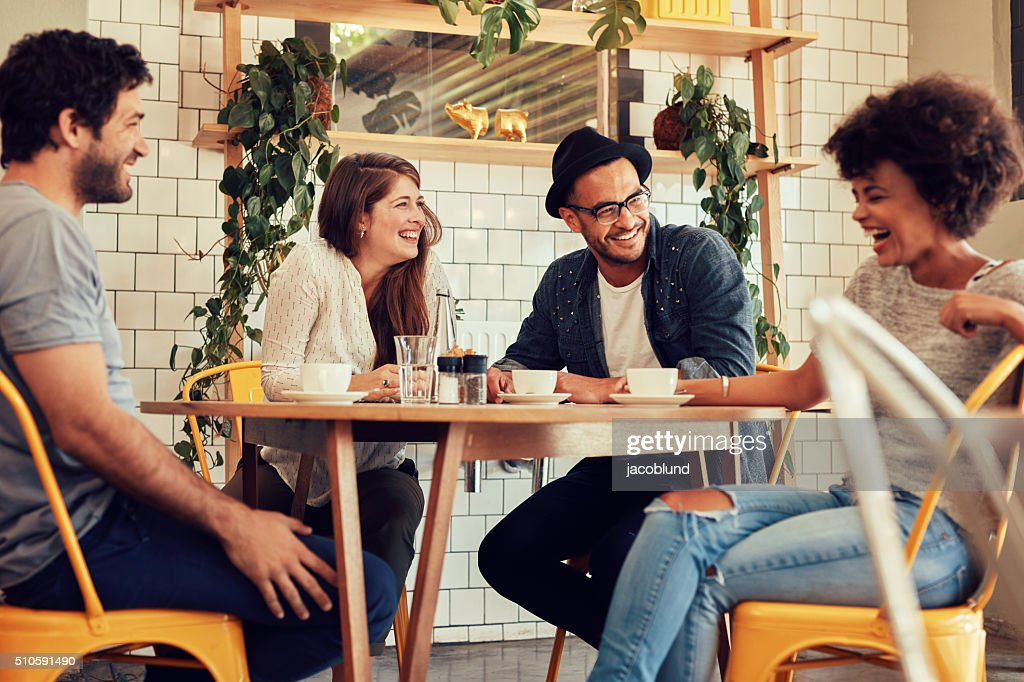 Friends having a great time in cafe : Stock Photo