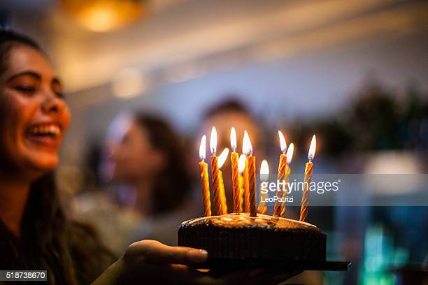 friends having a lot of fun at birthday party - birthday cake stock photos and pictures
