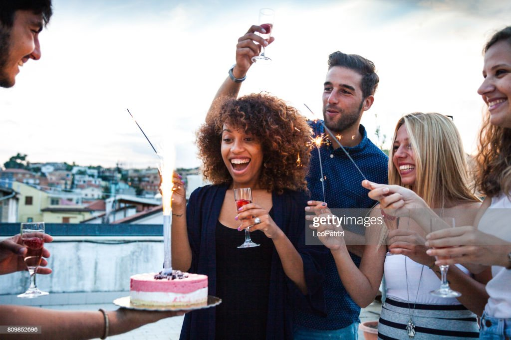 Friends having a lot of fun at birthday party : Stock Photo