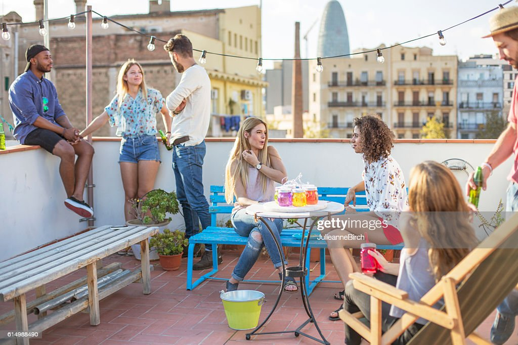 Friends having a party on the terrace : Photo
