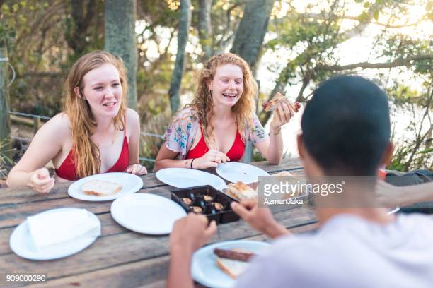Friends having a picnic and laughing