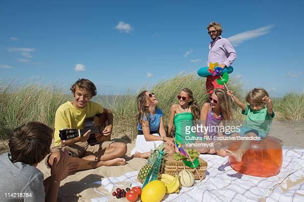 Friends having a picnic in the sand dune