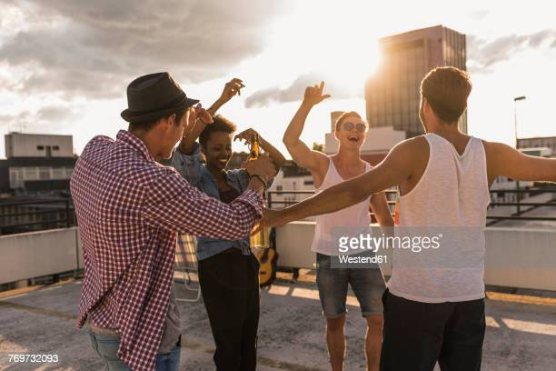 friends having a rooftop party - celebratory event stock pictures, royalty-free photos & images