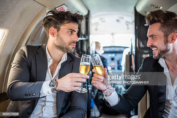 Friends having a toast in private jet airplane