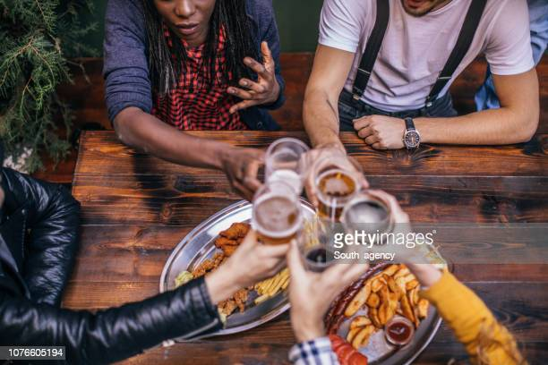 friends having a toast - ale stock pictures, royalty-free photos & images