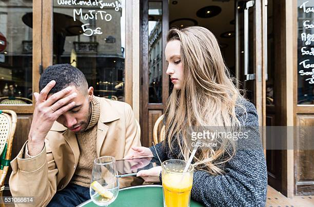 friends having an argument with digital tablet - paris fury stock pictures, royalty-free photos & images