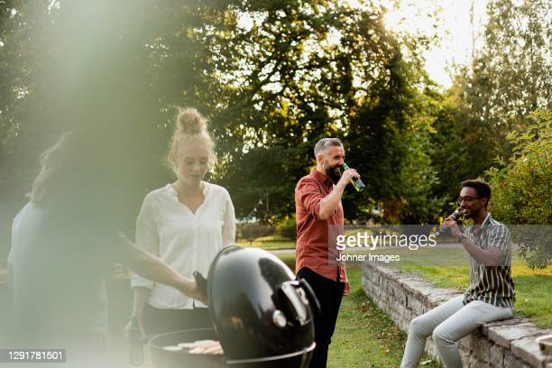 friends having barbecue - four people stock pictures, royalty-free photos & images