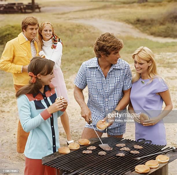 Friends having barbecue, smiling