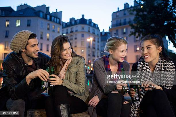 Friends having beer together outdoors